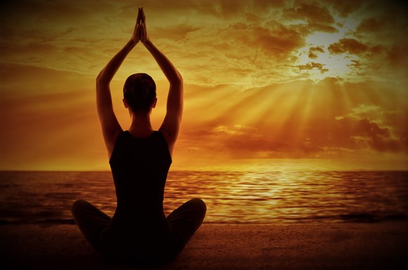 Yoga Meditation Concept Woman Silhouette Meditating in Healthy Pose Back View on Sun Light Rays