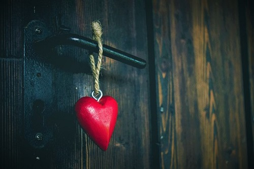 Close-Up Of Heart Shape Hanging To Door Handle